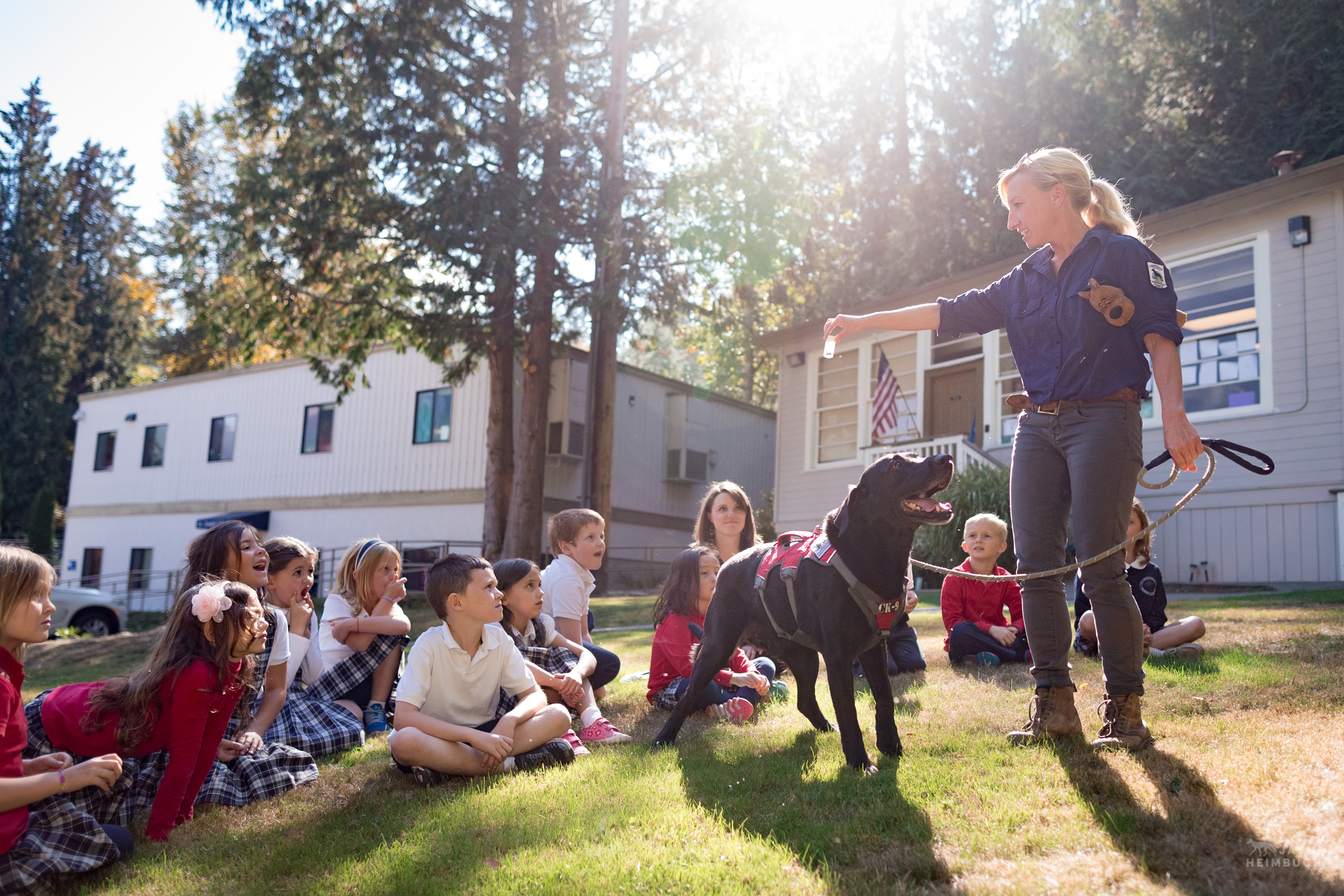 Field technician Julianne Ubigau teaches a classroom of second grade students about the work of Conservation Canines, a program with University of Washington's Center for Conservation Biology.